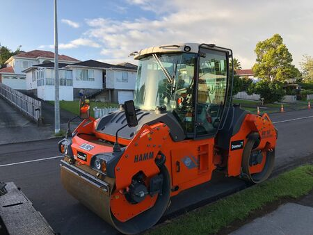 AUCKLAND, FEB. 21: A road roller sometimes called a roller-compactor, or just roller parked in side road located in Auckland, New Zealand taken on Feb. 21, 2018.