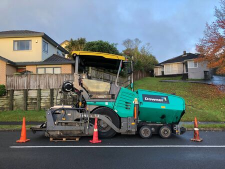 AUCKLAND, Jun.16: An asphalt paver,  paving or distributor equipment machinery parked in side of road taken on Jun. 16, 2018 in Auckland, New Zealand
