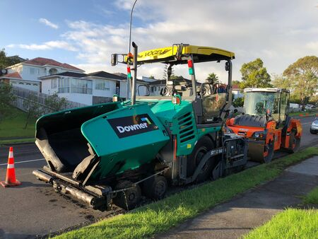 AUCKLAND, Feb. 12: An asphalt paver, paving or distributor equipment machinery and road roller parked in side of road taken on Feb. 12, 2018 in Auckland, New Zealand
