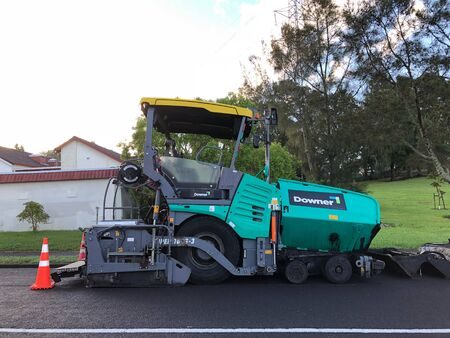 AUCKLAND, Feb. 12: An asphalt paver,  paving or distributor equipment machinery parked in side of road taken on Feb. 12, 2018 in Auckland, New Zealand