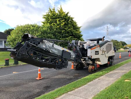 AUCKLAND, Feb. 23: A track asphalt paver,  paving or distributor equipment machinery parked in side of road taken on Feb. 23, 2018 in Auckland, New Zealand