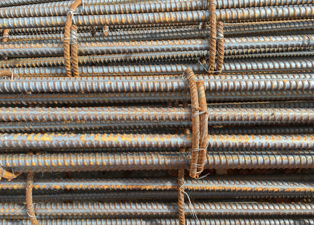 Close-up photo of a rebar, reinforcing bar, reinforcing steel and reinforcement steel, a steel bar or mesh of steel wires used as a tension device in reinforced concrete and masonry structures.