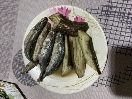 Photo of Inun unan, a Filipino dish where fish and vegetables like okra, bitter gourd, eggplant and or string beans are stewed on vinegar and spices, served on a plate.