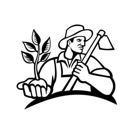 Black and white illustration of an organic farmer wearing a hat holding a plant by the palm of his hand with grab hoe on his shoulder looking to side on isolated background in retro style.