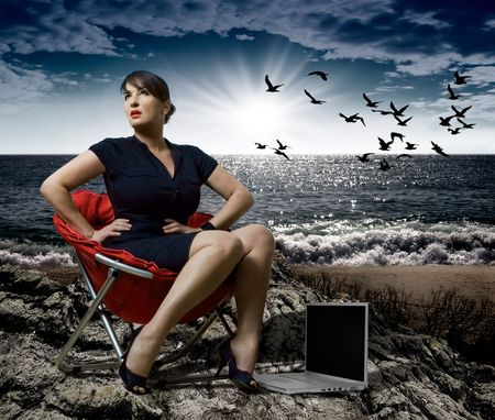 businesslady sitting beside the ocean, dramatic scene photo
