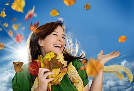 happy girl with flying leaves in autumn Stock Photo - 5215001
