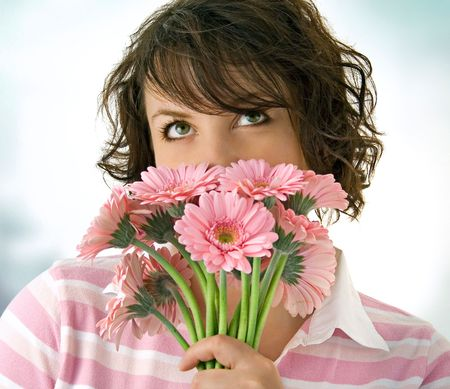 mother'sday: girl with rosa flowers looking on the ceiling Stock Photo