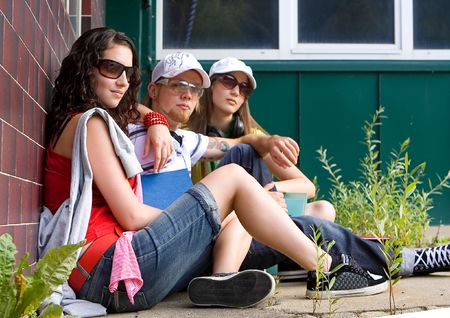 students are sitting beside a wall and making a rest Stock Photo - 5437856