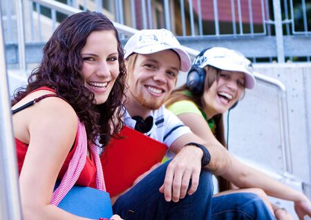 students sitting on the stairs of a schoolyard Stock Photo - 5437844