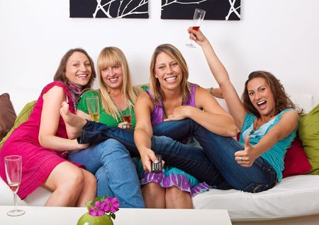 women laughing: pretty girls looking tv and making a little party