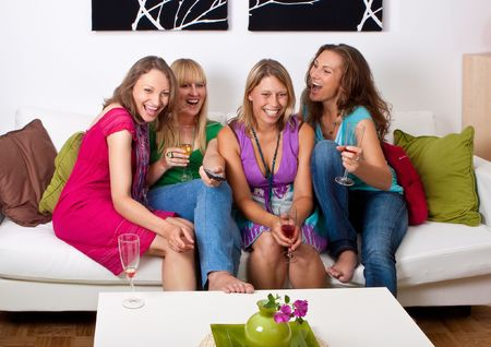 pretty girls looking tv and making a little party
