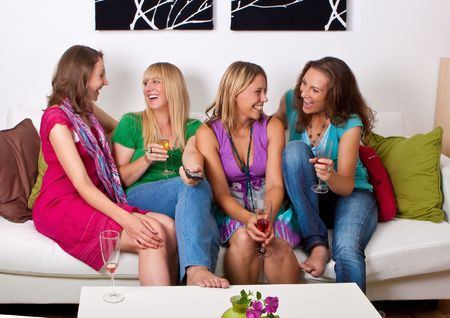 party friends: pretty girls looking tv and making a little party