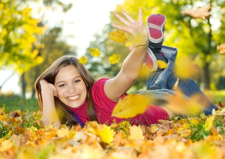 cute pretty girl in an autumn-park Stock Photo
