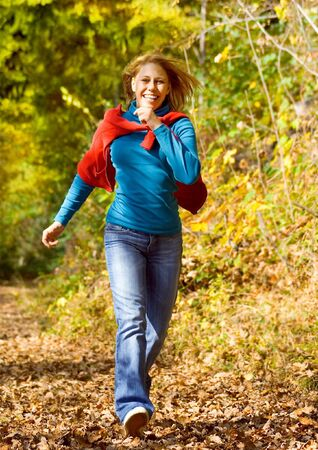girl taking a walk in an autumn-forest photo