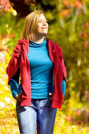 red jeans: girl taking a walk in an autumn-forest