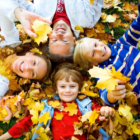 active family: a cute family in autumn