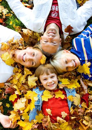 fall fun: a cute family in autumn