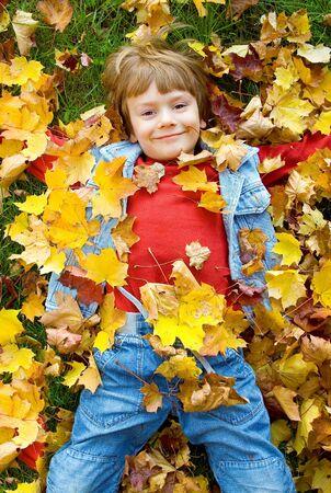 a cute boy in autumn photo