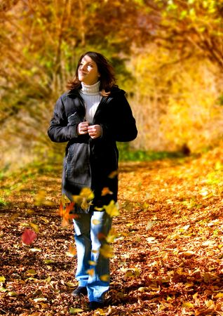 young beautiful girl walking in an autumn-forest Stock Photo