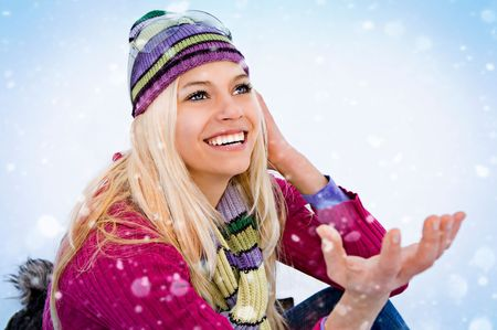 young blond cheerful girl in the snow photo