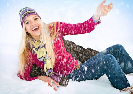 young, blond, cheerful girl in the snow photo