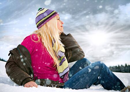 young blond girl in the snow photo
