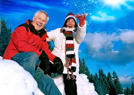 winter wedding: senior-couple having fun in wintertime Stock Photo