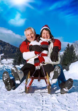 winter fun: senior-couple having fun in wintertime Stock Photo