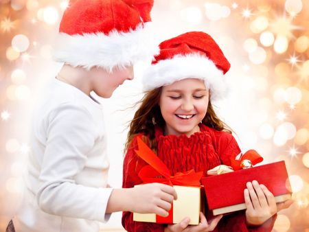 kid friendly: two sweet kids with christmas-presents Stock Photo