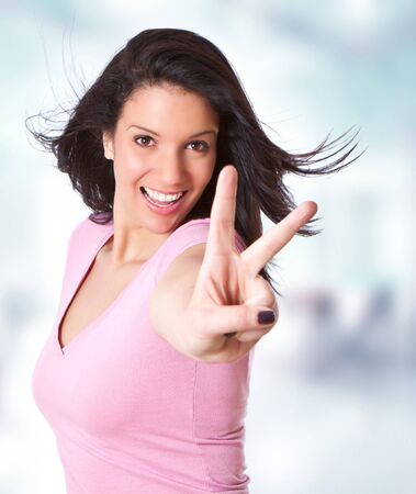 likable: beautiful young girl making a victory sign