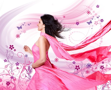 beautiful girl with a pink dress and flying hair photo
