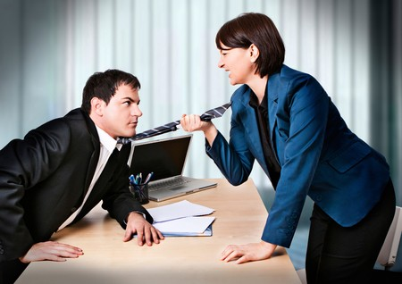 contestation: businesswoman and businessman are fighting