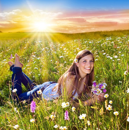 marguerite: beautiful young girl lying in a sunset marguerite meadow
