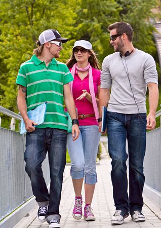go: three students on the campus Stock Photo