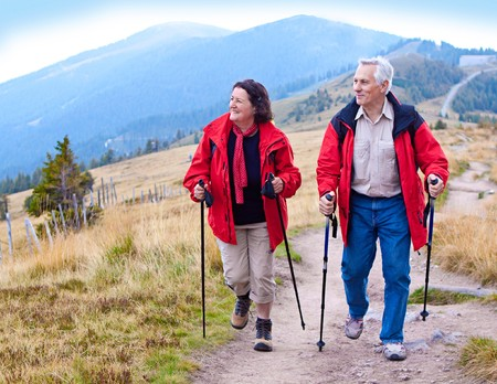 nordic walking: seniorcouple hiking in the nature Stock Photo