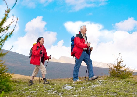 old people walking: seniorcouple hiking in the nature Stock Photo