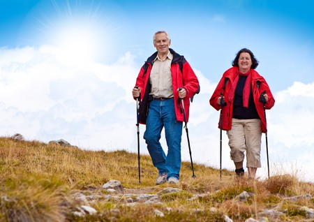 seniorcouple hiking in the nature Stock Photo - 7365988