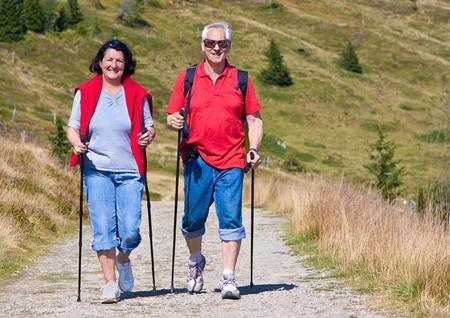 seniorcouple hiking in the nature photo