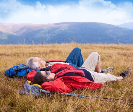 nordic nature: senior-couple hiking in the nature