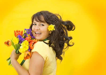 beautiful girl with spring-flowers photo