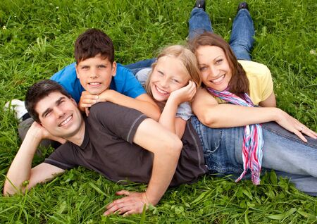 cute young family having fun in the nature photo
