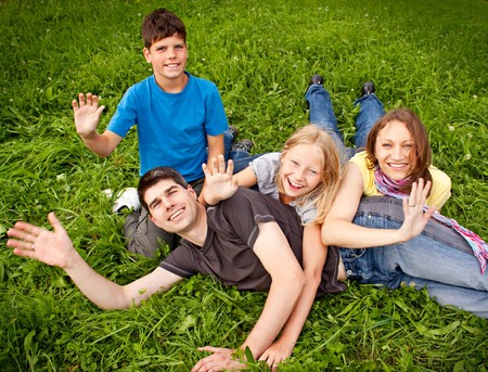 young family having fun in the nature photo