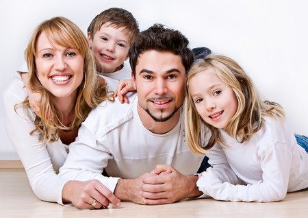 adorable home: sweet young family having fun on the floor in their home