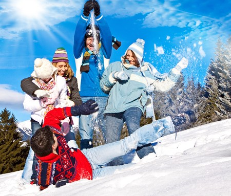 cute family having fun in the snow Stock Photo - 7557581