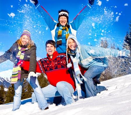 cute family having fun in the snow Stock Photo