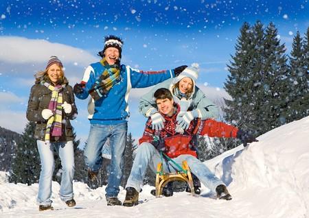 sledging: friends having fun in inverno