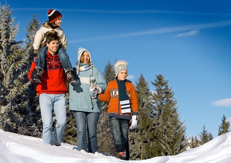 young family in winter landscape photo