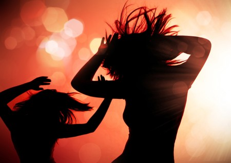 dancing silhouettes of woman in a nightclub Stock Photo