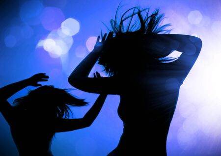 dancing pose: dancing silhouettes of women in a nightclub