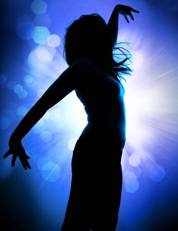 pleasures: dancing silhouettes of woman in a nightclub Stock Photo